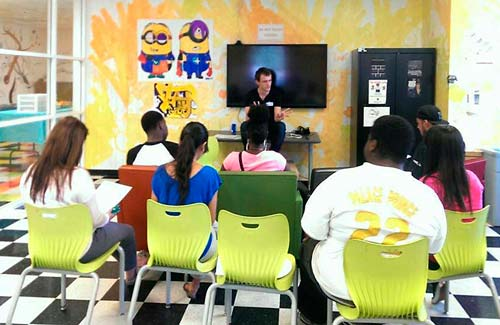 A peer mentor talks about career options with young people at the TAY Hot Spot in Carson.