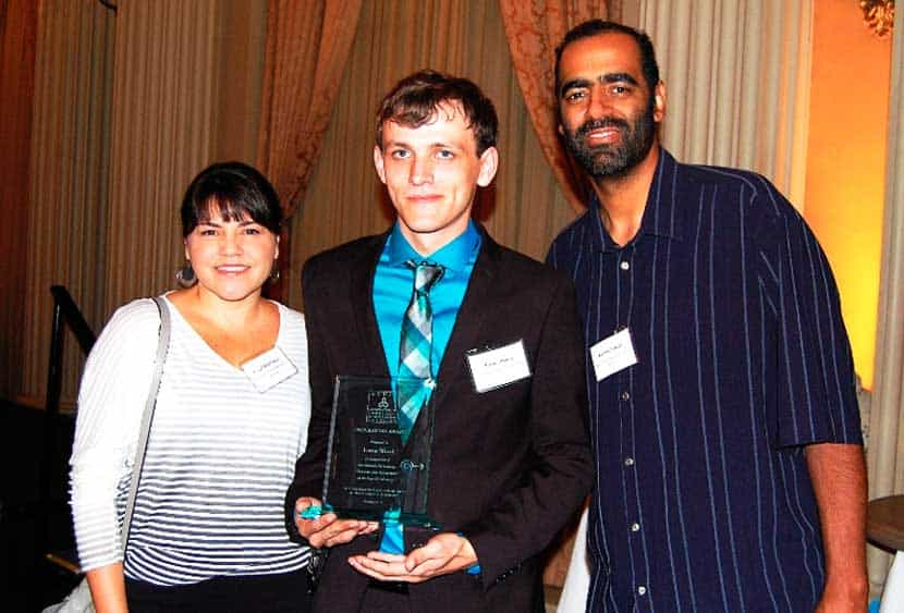Lorne accepts the ACHSA's Inspiration Award with his former Star View counselors, Coral Huntsman and Kenny Langie.
